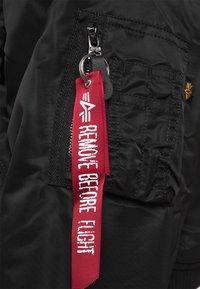 Alpha Industries - REVERISIBLE  BOMBER JACKET  - Bomber Jacket - black - 7