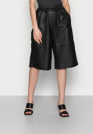 EDIE SHORTS - Leather trousers - black