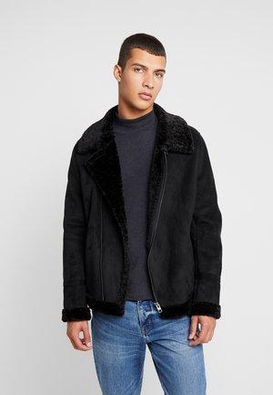 JUSTIN - Faux leather jacket - black