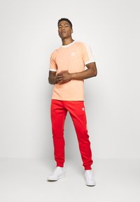 adidas Originals - Jogginghose - red - 1