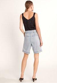 comma - Denim shorts - light blue - 2