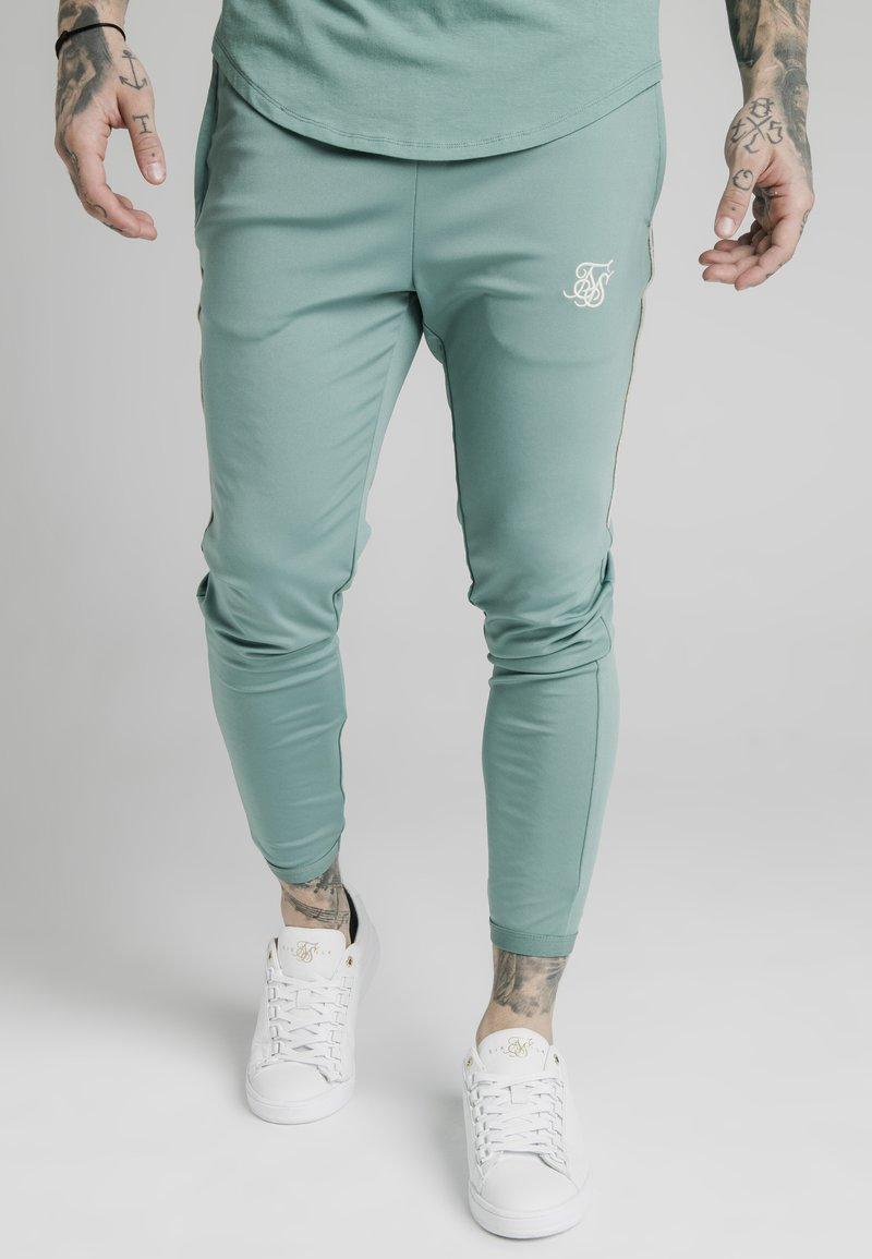 SIKSILK - Pantaloni sportivi - light petrol blue