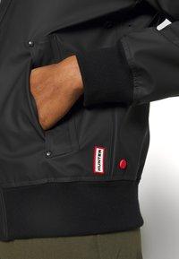 Hunter ORIGINAL - WOMENS ORIGINAL LIGHTWEIGHT JACKET - Faux leather jacket - black - 6