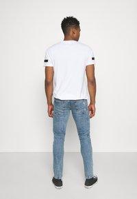 Redefined Rebel - STOCKHOLM DESTROY - Slim fit jeans - pearl blue - 2