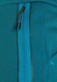 Nike Sportswear - TONE - Tracksuit bottoms - dark teal green/blustery - 6
