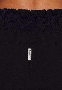 Deha - ECO WEAR YOGA PANTS - Trainingsbroek - black - 4