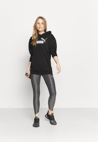 Puma - ELONGATED LOGO HOODIE - Sweatshirt - black - 1
