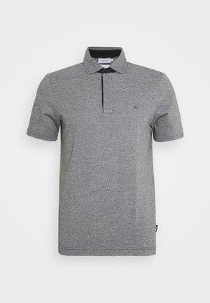 LIQUID HEATHER - Polo shirt - black