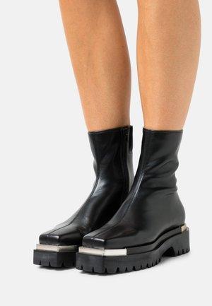 DEVOUT - Platform ankle boots - black