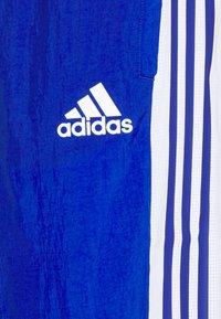 adidas Performance - TRACK - Träningsbyxor - team royal blue/white/scarlet - 6