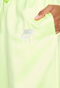 Nike Sportswear - Tracksuit bottoms - lime ice/white - 6