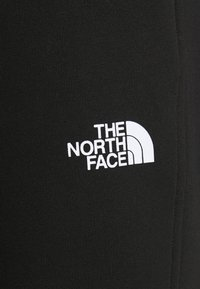 The North Face - STANDARD PANT - Tracksuit bottoms - black - 4