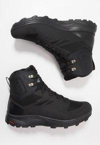 Salomon - OUTBLAST TS CSWP - Winter boots - black - 1