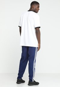 adidas Performance - TIRO 19 - Tracksuit bottoms - darkblue/white - 2