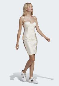 adidas Originals - PAOLINA RUSSO COLLAB SPORTS INSPIRED SLIM DRESS - Sukienka etui - chalk white - 0