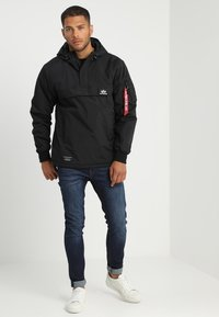Alpha Industries - ANORAK FUNKTION - Light jacket - black - 1