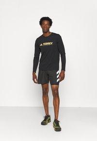 adidas Performance - Terrex TRAIL LONGSL FOUNDATION PRIMEBLUE RUNNING LONG SLEEVE T-SHIRT - Long sleeved top - black - 1