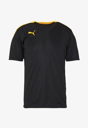 FTBLNXT - T-shirt med print - black/ultra yellow