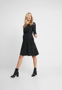 Noppies - DRESS NURS TATUM - Jerseykleid - black - 1