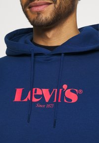 Levi's® - PEANUTS RELAXD GRAPHIC HOODIE - Jersey con capucha - blues - 4