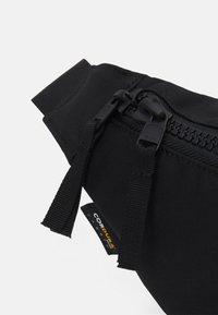 Peak Performance - SLING BAG UNISEX - Bum bag - black - 3