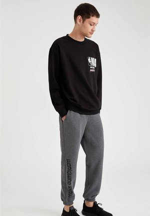OVERSIZED - Tracksuit bottoms - anthracite
