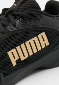Puma - JARO FRESH - Neutral running shoes - black/team gold - 5
