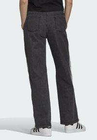 adidas Originals - Dry Clean Only xDENIM ADIBREAK - Flared jeans - black - 1