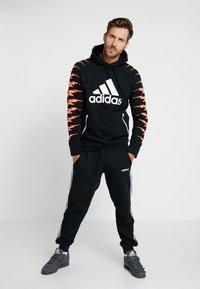 adidas Performance - Jersey con capucha - black - 1
