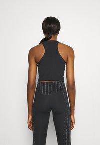 Nike Performance - TANK - Toppi - black/white - 2