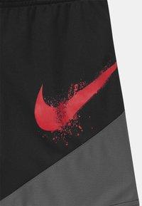 Nike Sportswear - DOMINATE - Tracksuit bottoms - black - 2