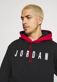 Jordan - JUMPMAN AIR - Sudadera - black/gym red - 3