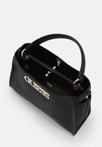 Guess - UPTOWN CHIC TURNLOCK SATCHEL - Handbag - black - 2
