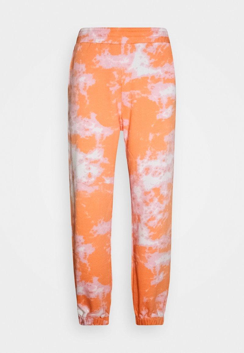 Sweet SKTBS - SWEET UNISEX - Tracksuit bottoms - orange
