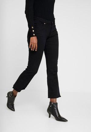 GYM KICK - Široké džíny - black
