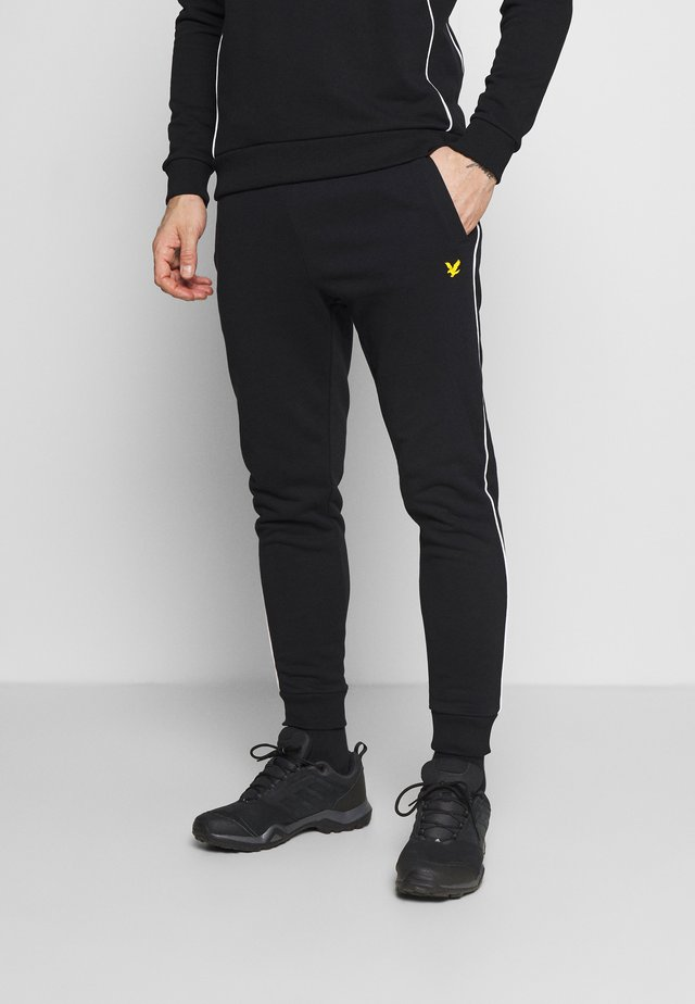 WITH CONTRAST PIPING - Pantaloni sportivi - true black