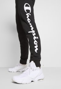 Champion - LEGACY CUFF PANTS - Jogginghose - black/grey - 4