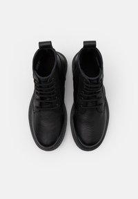 DECHASE - GUZO UNISEX - Lace-up ankle boots - black - 3