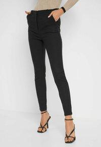 ORSAY - HIGH WAIST - Trousers - schwarz - 0