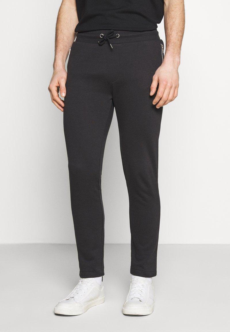 Zign - Tracksuit bottoms - black