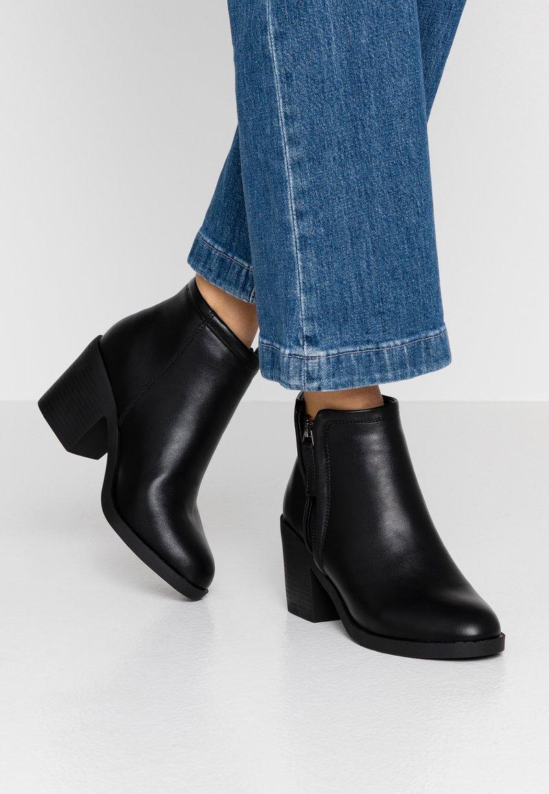 Topshop - BONDI ZIP UNIT - Ankle boots - black