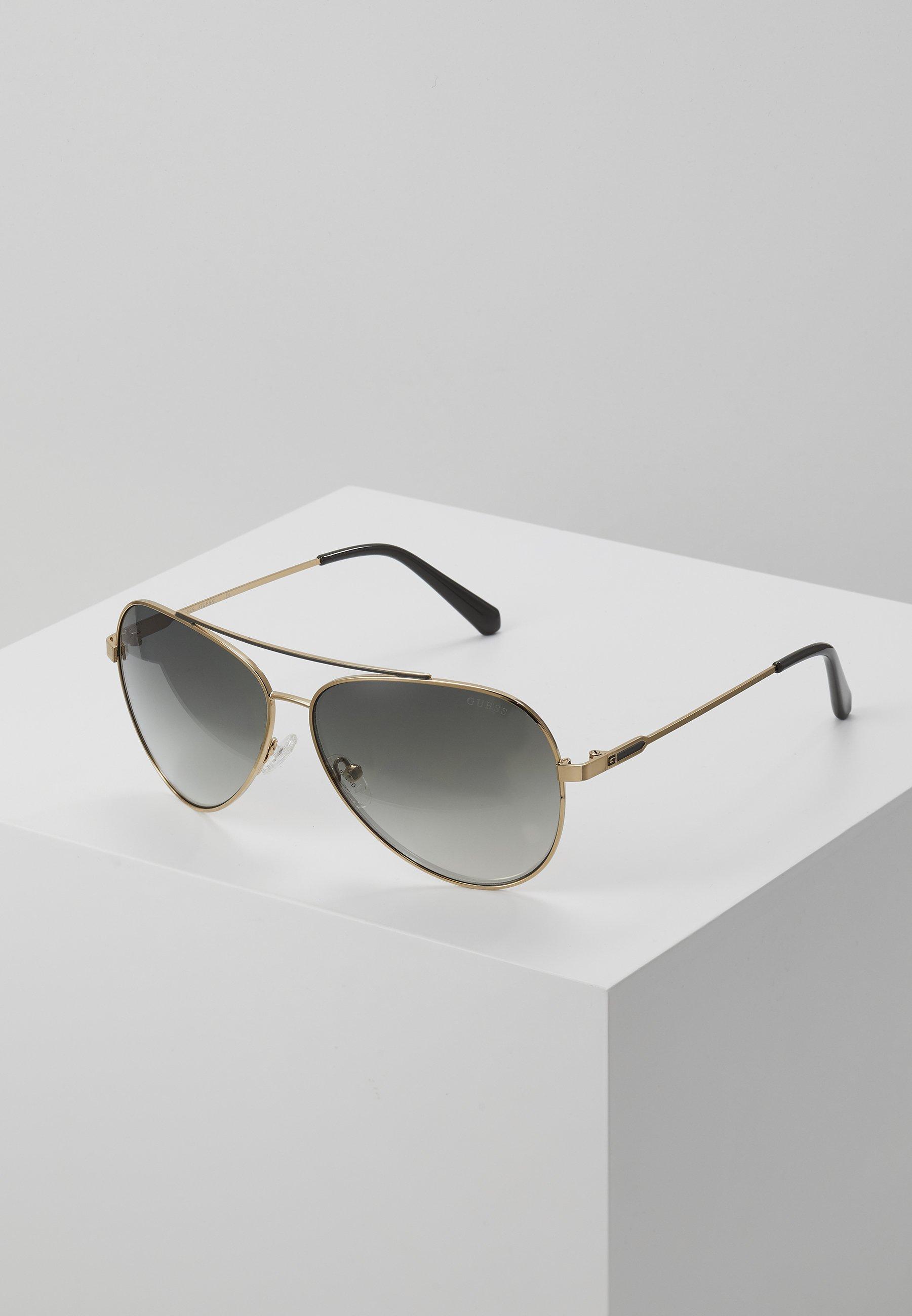 Dobra sprzedaż Gorąca wyprzedaż Guess Okulary przeciwsłoneczne - gold-coloured/green gradient | Akcesoria męskie 2020 500cC