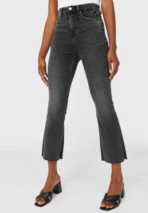 CROPPED-SCHLAGHOSE - Flared Jeans - dark grey