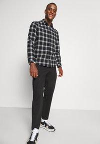 Selected Homme - SLHSLIMTAPE JIM STRING FLEX - Trousers - black - 3