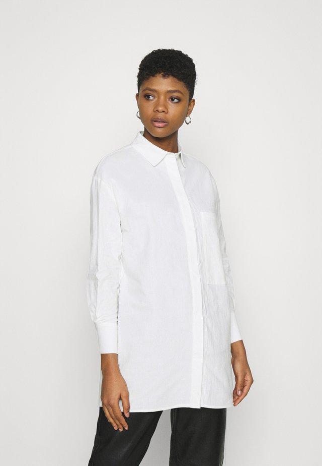 GENESIS - Tunika - white