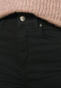 ONLY - ONLBLUSH HIGH WAIST - Jeans Skinny Fit - black denim - 4