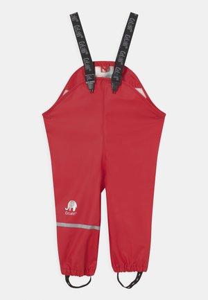 RAINWEAR PANTS SOLID UNISEX - Rain trousers - red