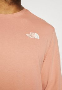 The North Face - GRAPHIC TEE UTILITY - Top sdlouhým rukávem - pink clay - 4