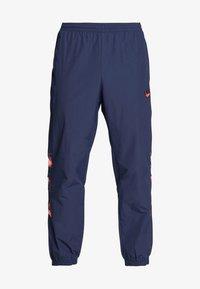 adidas Originals - FOOTBALL GRAPHIC TRACK PANTS - Tracksuit bottoms - blue - 4