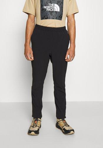 TECH PANT - Teplákové kalhoty - black